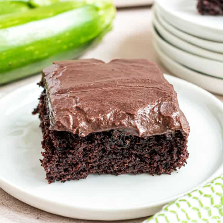 Slice of chocolate brownie with chocolate frosting.