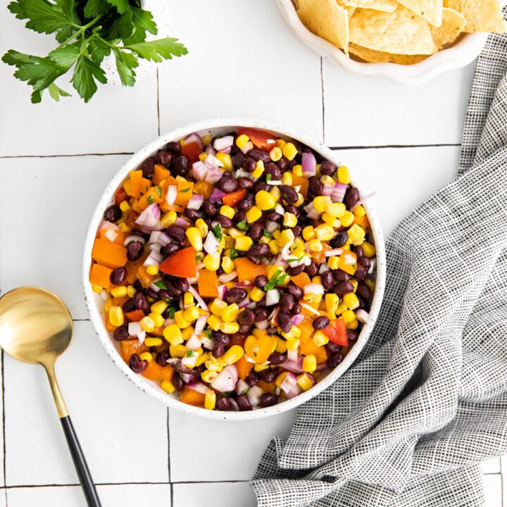 Forget buying jars of salsa when you can make this delicious Corn and Black Bean Salsaat home! With jalapeno peppers and a hint of lime, this homemade salsa is perfect for scooping with chips or adding to your tacos.