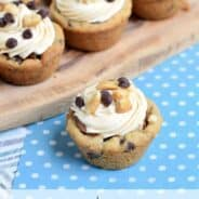 Easy Snickers Cookie Cups made with refrigerated cookie dough and candybars. Take the extra step and make the caramel frosting, so