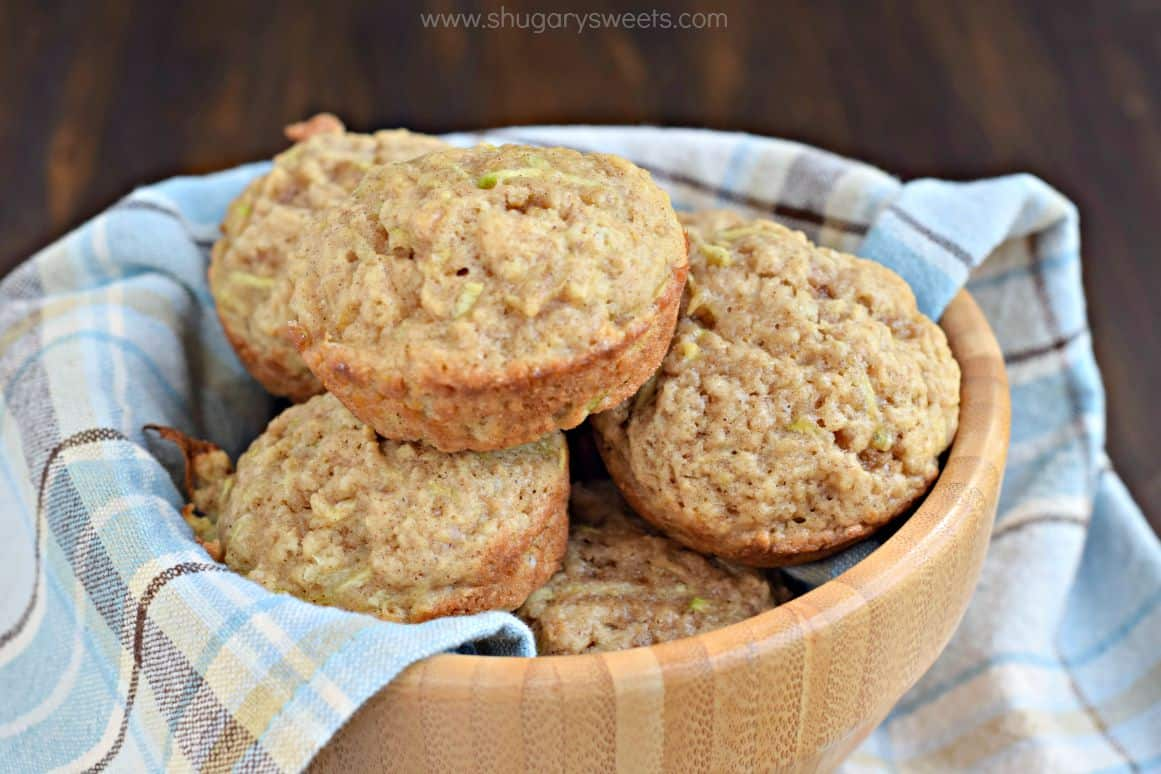 Zucchini muffins in a wooden bowl for serving.