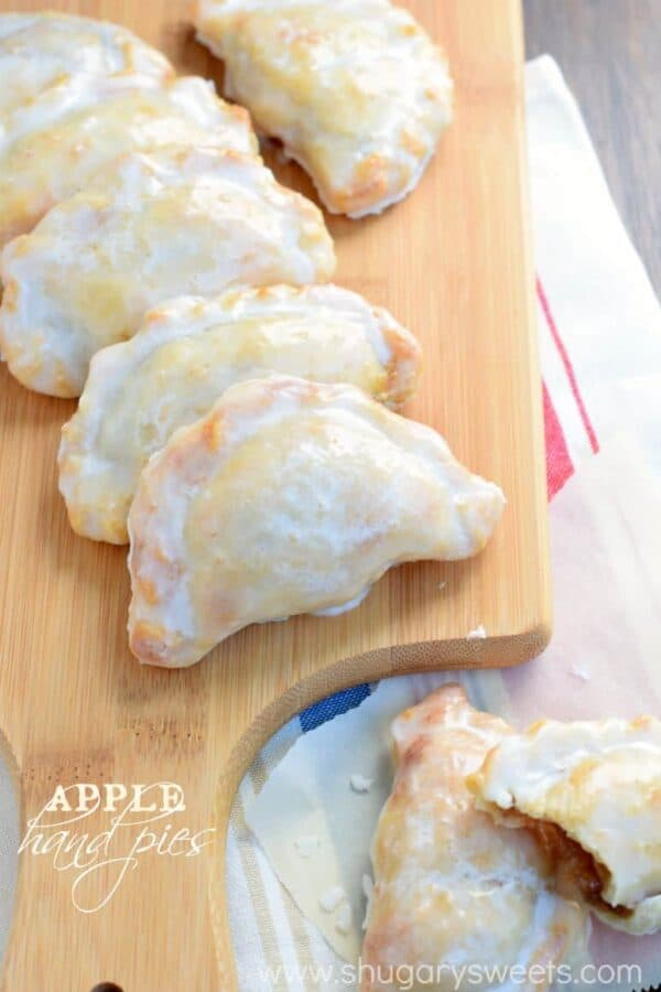 Glazed Apple Hand Pies on wood cutting board