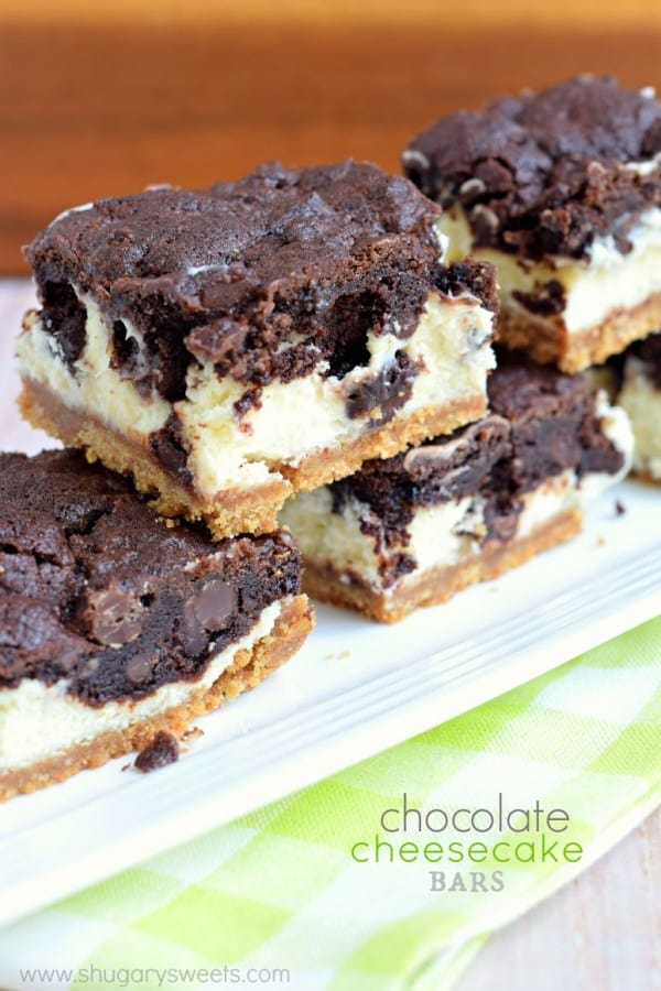 Chocolate Cheesecake Bars: graham cracker crust, creamy vanilla cheesecake and chocolate cookie crunch on top make these the perfect dessert!