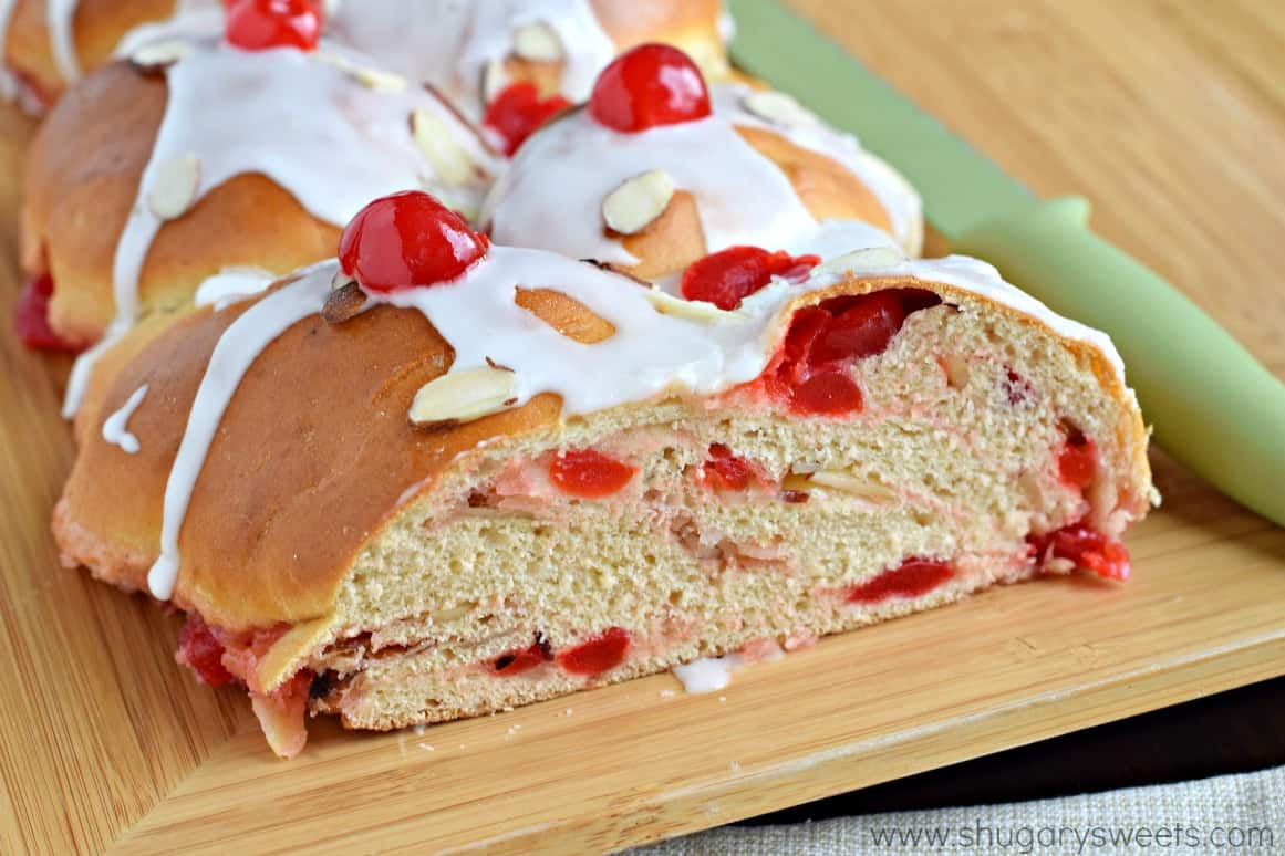 Cherry almond braid with a slice removed.