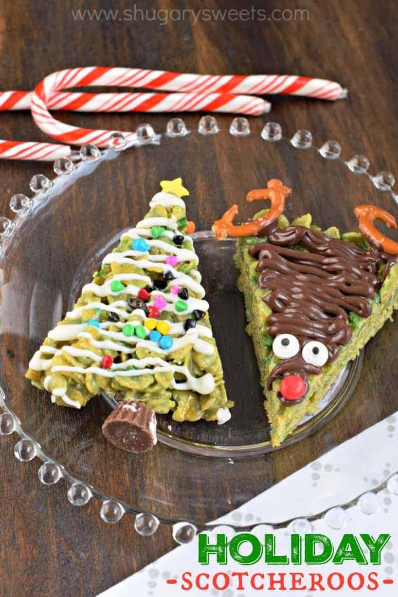Scotcheroos shaped like christmas tree and reindeer on glass plate.