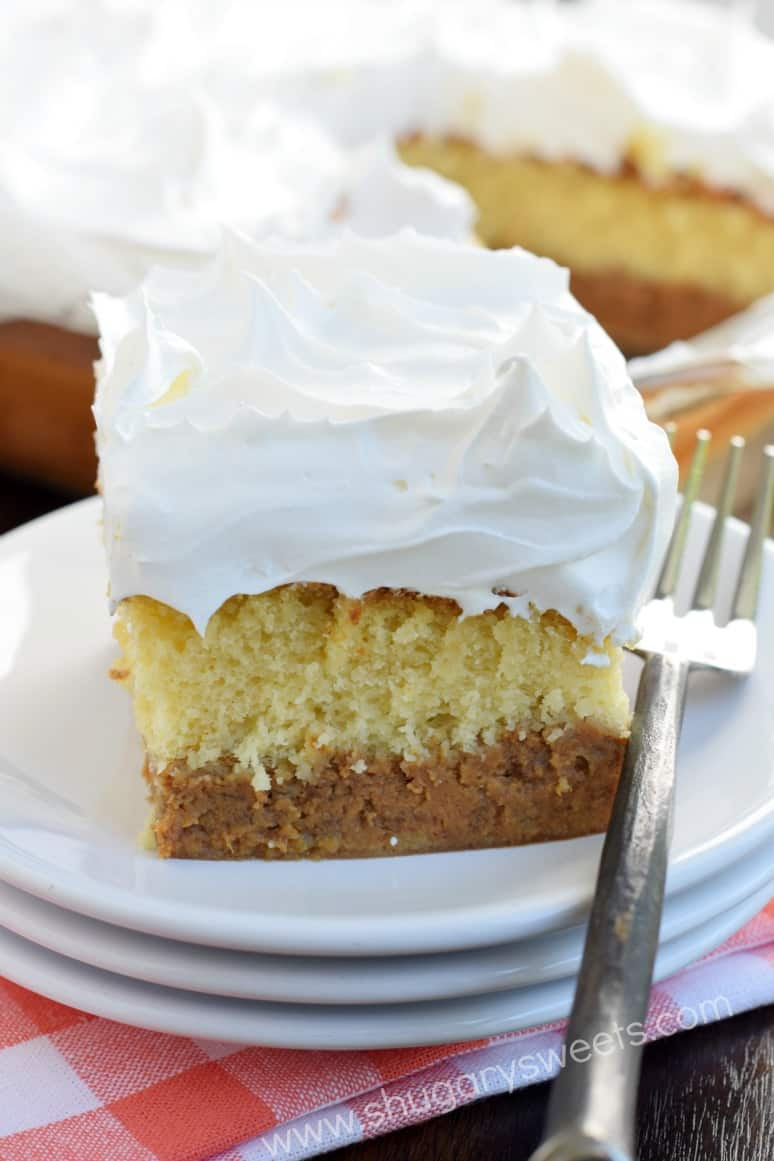 Cake with a layer of pumpkin pie, and topped with whipped cream.