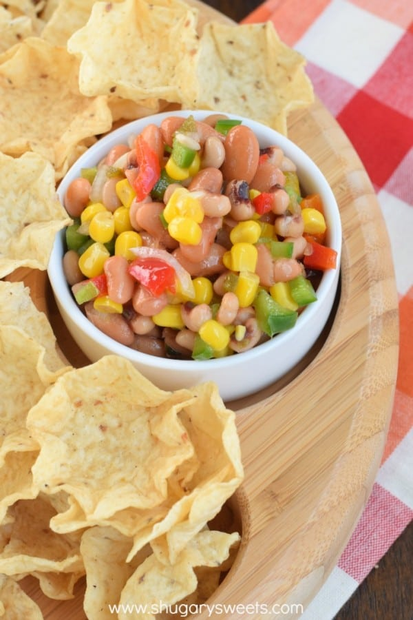 The SWEET oil and vinegar dressing makes this BEAN DIP recipe quite addicting! The perfect game day snack!