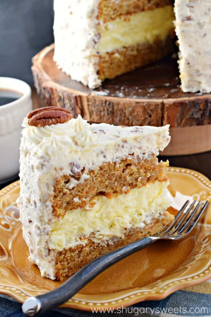 Slice of Carrot Cake Cheesecake Cake on a yellow plate.