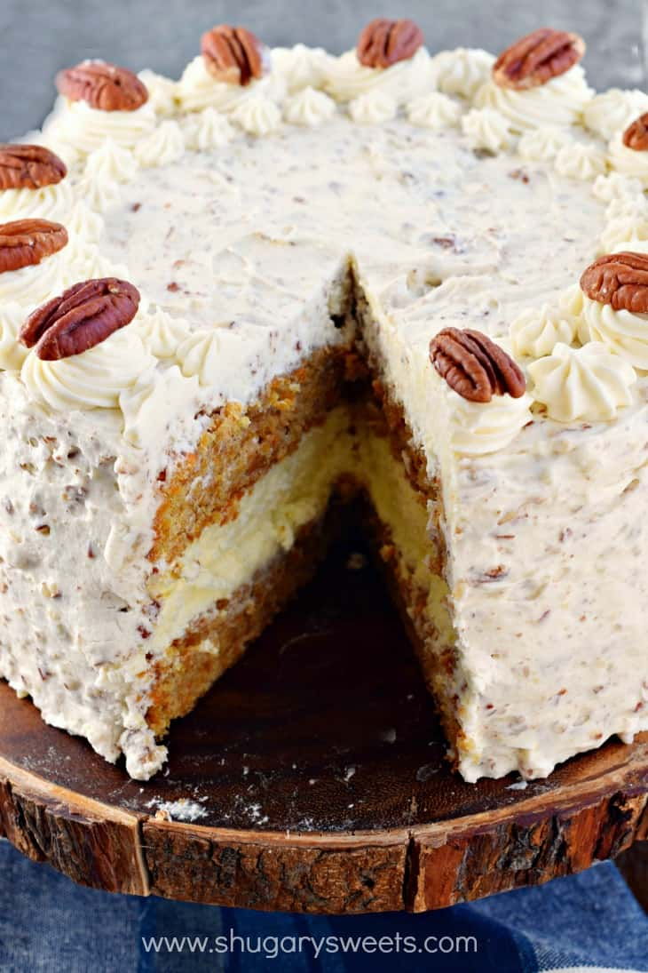 Carrot Cake Cheesecake Cake Cream Cheese Frosting with one slice removed.