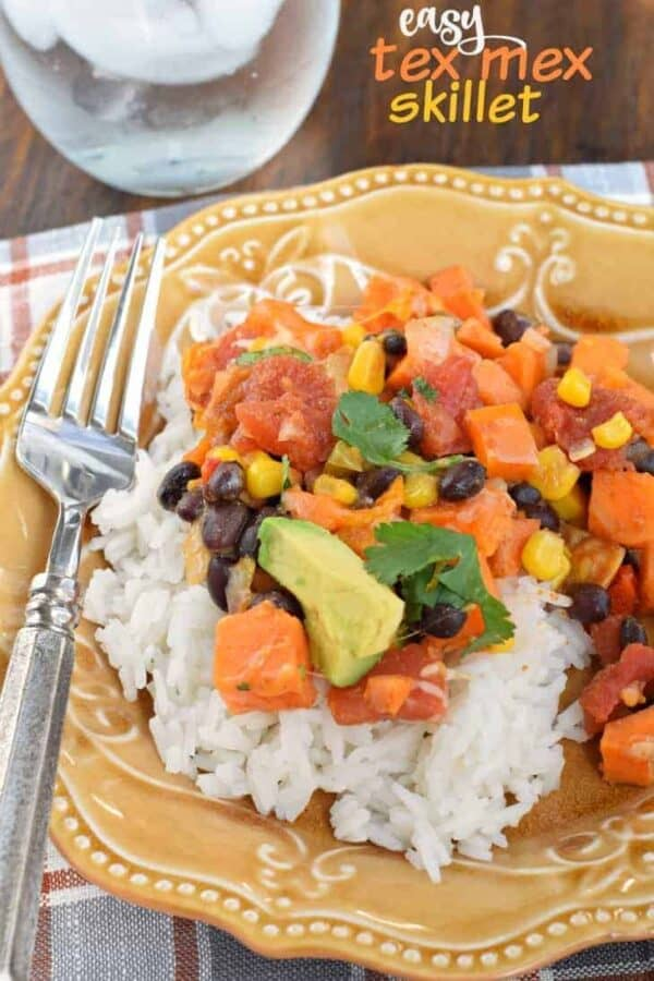 This easy, weeknight Sweet Potato Tex Mex Skillet is delicious and hearty. Perfect for meatless Mondays, and you can leave out the cheese for a vegan dinner idea!