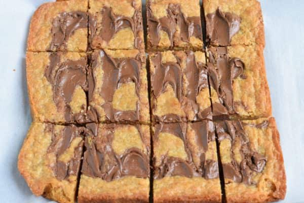 Easy, chewy, Nutella Swirled Blondies. Topped with ice cream, melted Nutella and sprinkles! Perfect way to celebrate that special occasion!