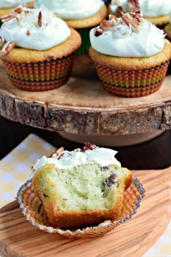 You're going to LOVE these Watergate Cupcakes! Extremely nutty and moist thanks to pistachio pudding and pecans. Topped with a sweet, light whipped frosting, which is perfect for summer!