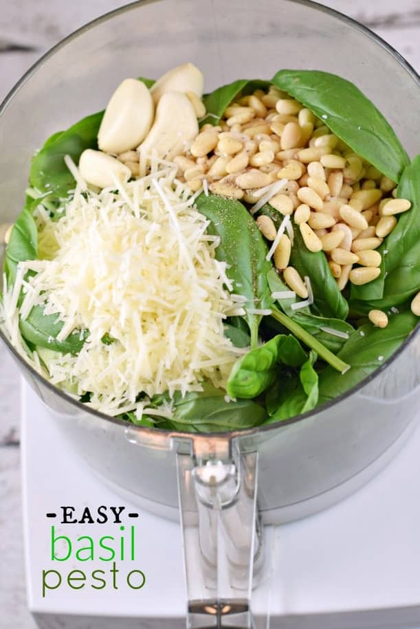 Pesto ingredients in a food processor before blending.