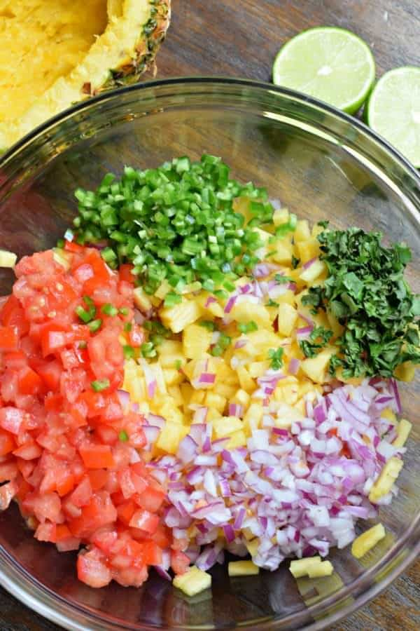 Tropical Pineapple Salsa is a spicy, sweet, colorful snack idea! So versatile, you can enjoy with tortilla chips or spoon it over your favorite grilled chicken or fish!