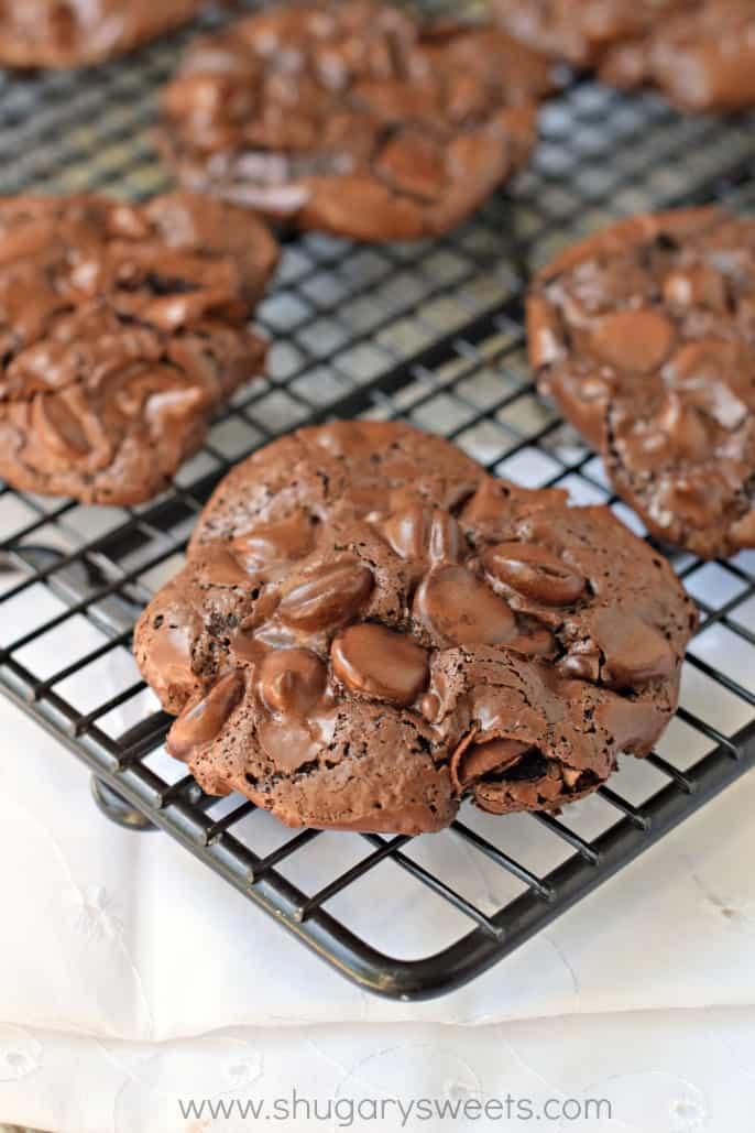 Black wire rack with chocolate meringue cookies.