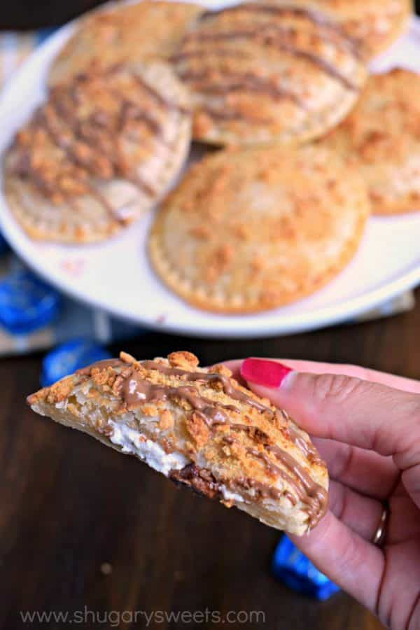 No campfire needed for these Ooey Gooey BAKED S'mores Hand Pies! They're filled with marshmallow cream and rich DOVE® Milk Chocolate candy and topped with a crunchy graham coating. Who can resist?