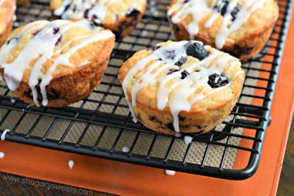 Easy, moist Blueberry Zucchini Muffins are the perfect breakfast or on-the-go snack! They freeze well too, with or without the sweet glaze!