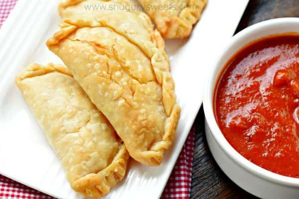 Flaky pie crust filled with pepperoni and cheese. These baked Pepperoni Pizza Hand Pies are ready in minutes and make a great meal!