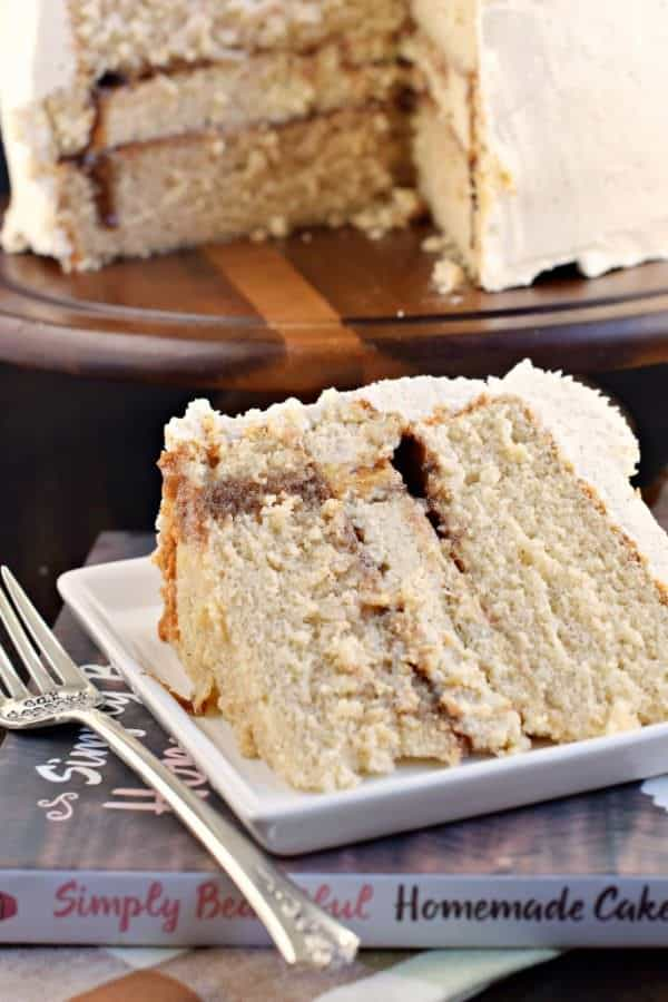 If you're looking for a delicious dessert, give this Cinnamon Roll Cheesecake Cake a try! Layers of homemade cinnamon cake and cinnamon cheesecake topped with a sweet, cinnamon frosting!