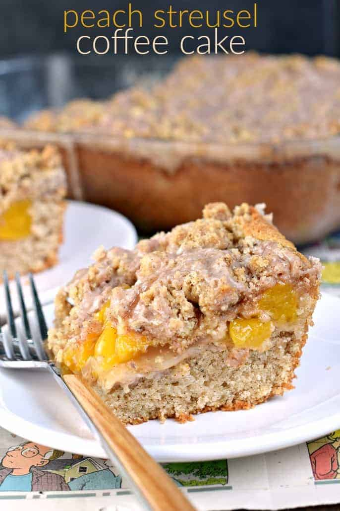 Slice of peach coffee cake on a white plate.