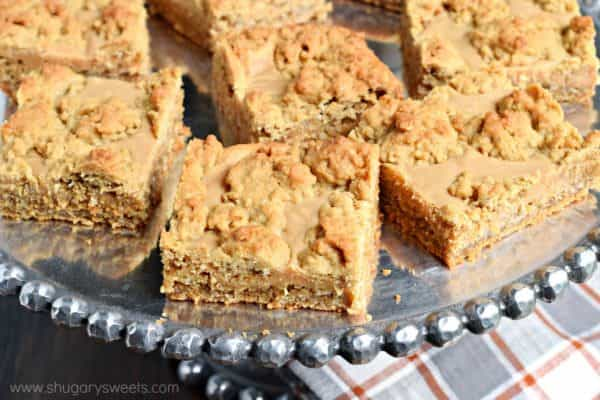 Peanut Butter Revel Bars are a sweet, chewy cookie bar, perfect for potlucks, holidays, and bake sales. Also freezes well for later!