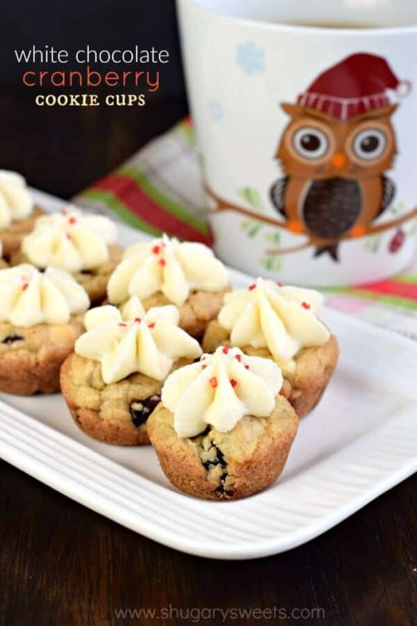 Chewy White Chocolate Cranberry Cookie Cups with a creamy, buttercream frosting swirl on top!