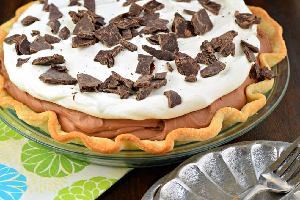 French silk pie topped with chocolate chunks.