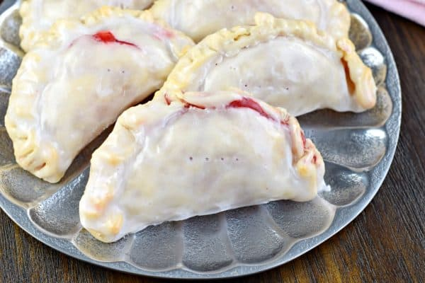 These Strawberry Hand Pies are the perfect dessert. And in about 30 minutes, you'll have one of these delicious baked treats in your hands! Great for Valentine's Day too!