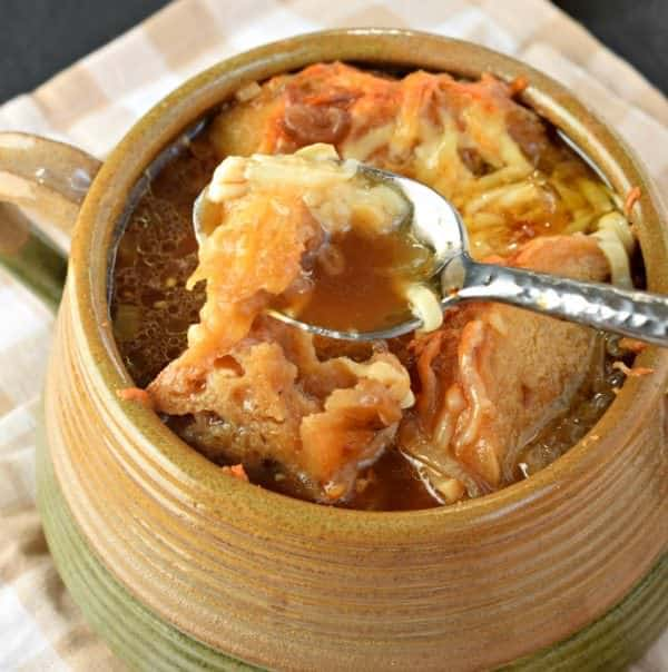 Sweet onions, rich broth and toasty cheese combined together to make the best French Onion Soup recipe ever!