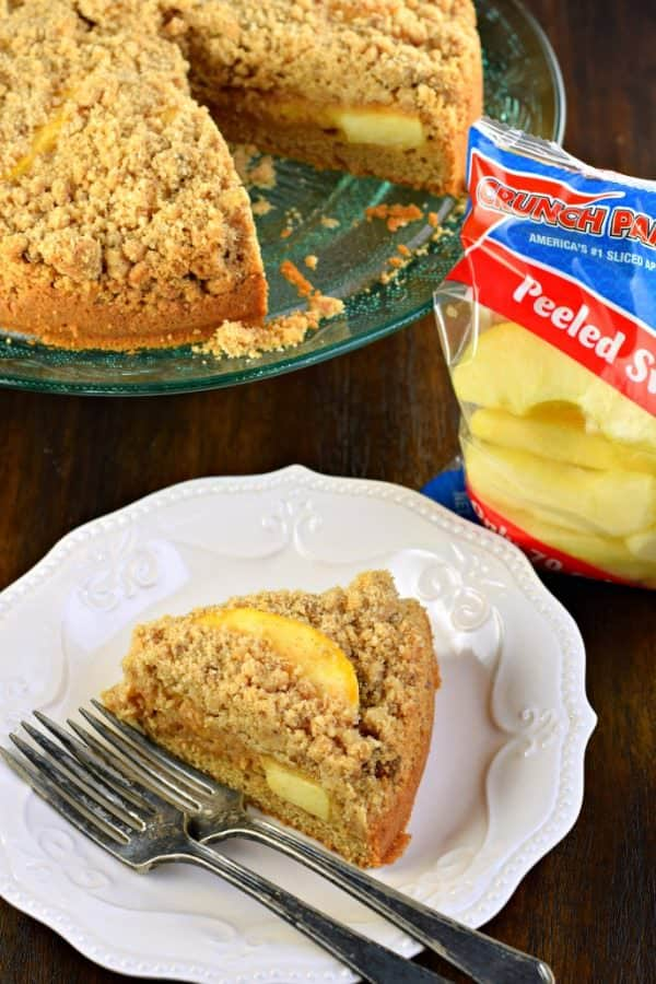 Sweet Cinnamon Apple Crumb Cake with a dense layer of cake, cinnamon apple filling and topped with a crunchy cinnamon streusel! The perfect breakfast!