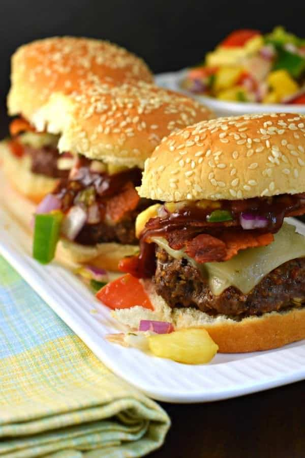 Hawaiian Sliders are juicy, tangy Beef and Bacon Burgers with a homemade Pineapple Salsa. You'll love this delicious dinner idea!