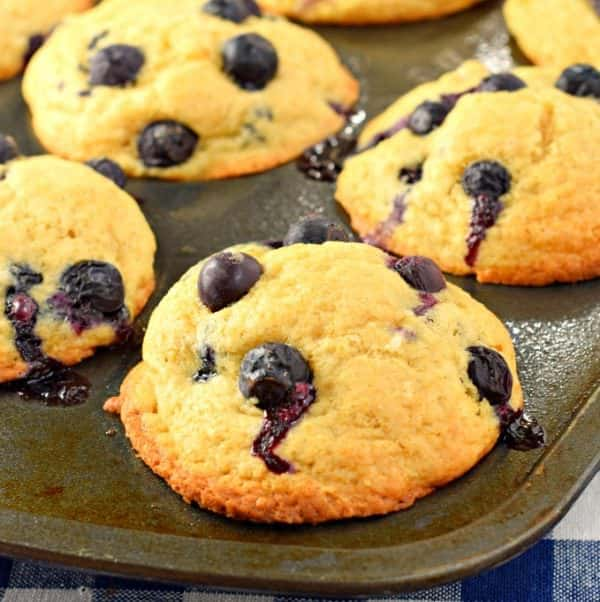 Big, Bakery Style Blueberry Muffins packed with flavor and blueberries! You'll love these freezer friendly breakfast bites!