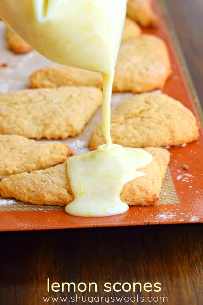 Bag of lemon glaze being drizzled over lemon scones.