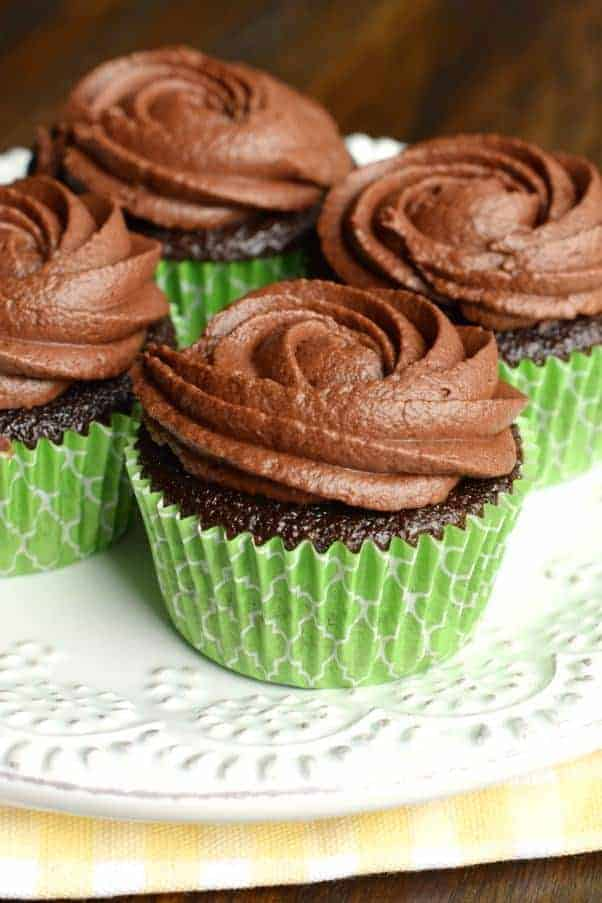 These Chocolate Frosted Chocolate Cupcakes start with the most delicious cupcake recipe ever! Then topped with a creamy, chocolate buttercream frosting with a secret ingredient!