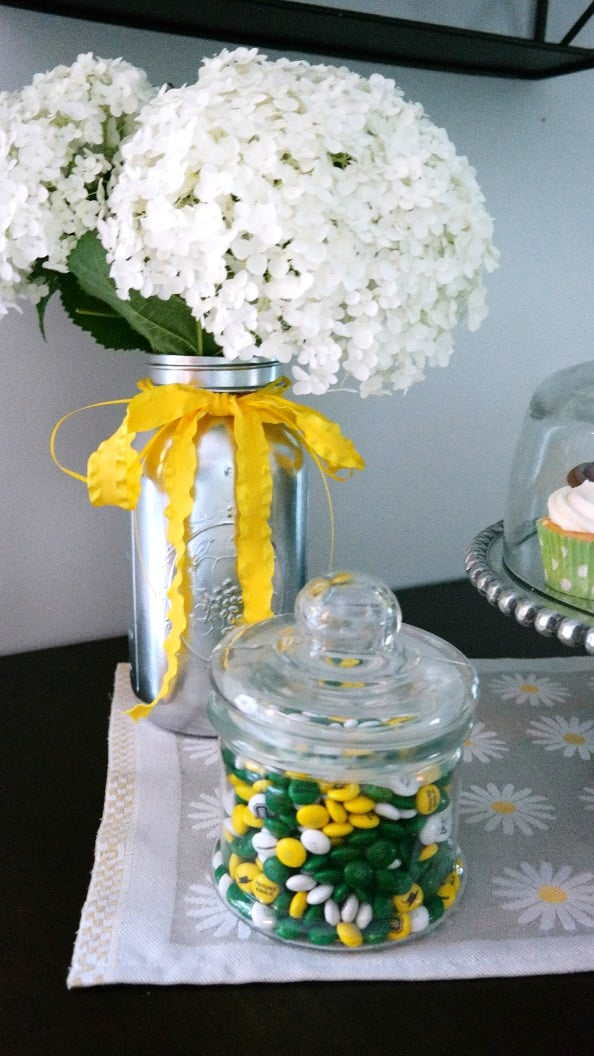 Spray Paint mason jars silver and add flowers from your garden for centerpieces!