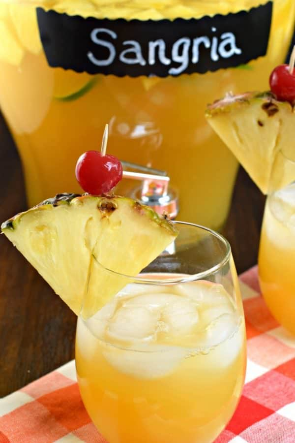 Pineapple Sangria is the perfect, refreshing summer drink! Packed with fruit, juice, and alcohol, you should whip up a batch today!