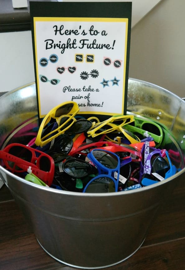 Here's to a Bright Future...take a pair of sunglasses home! Fun Graduation party idea!