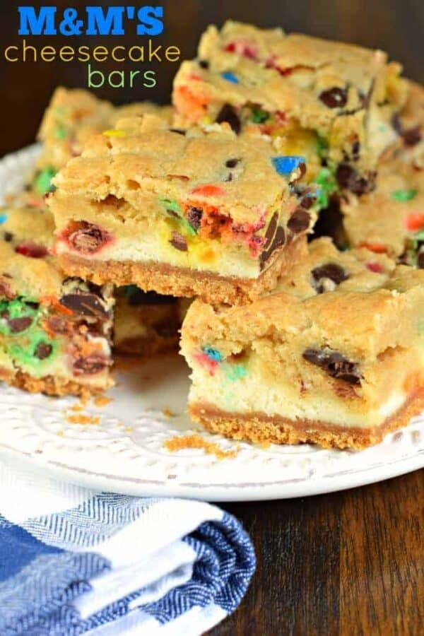 These M&M Cheesecake Bars have a sweet graham cracker crust, creamy cheesecake filling, and a chocolate chip cookie dough packed with M&M's on top!