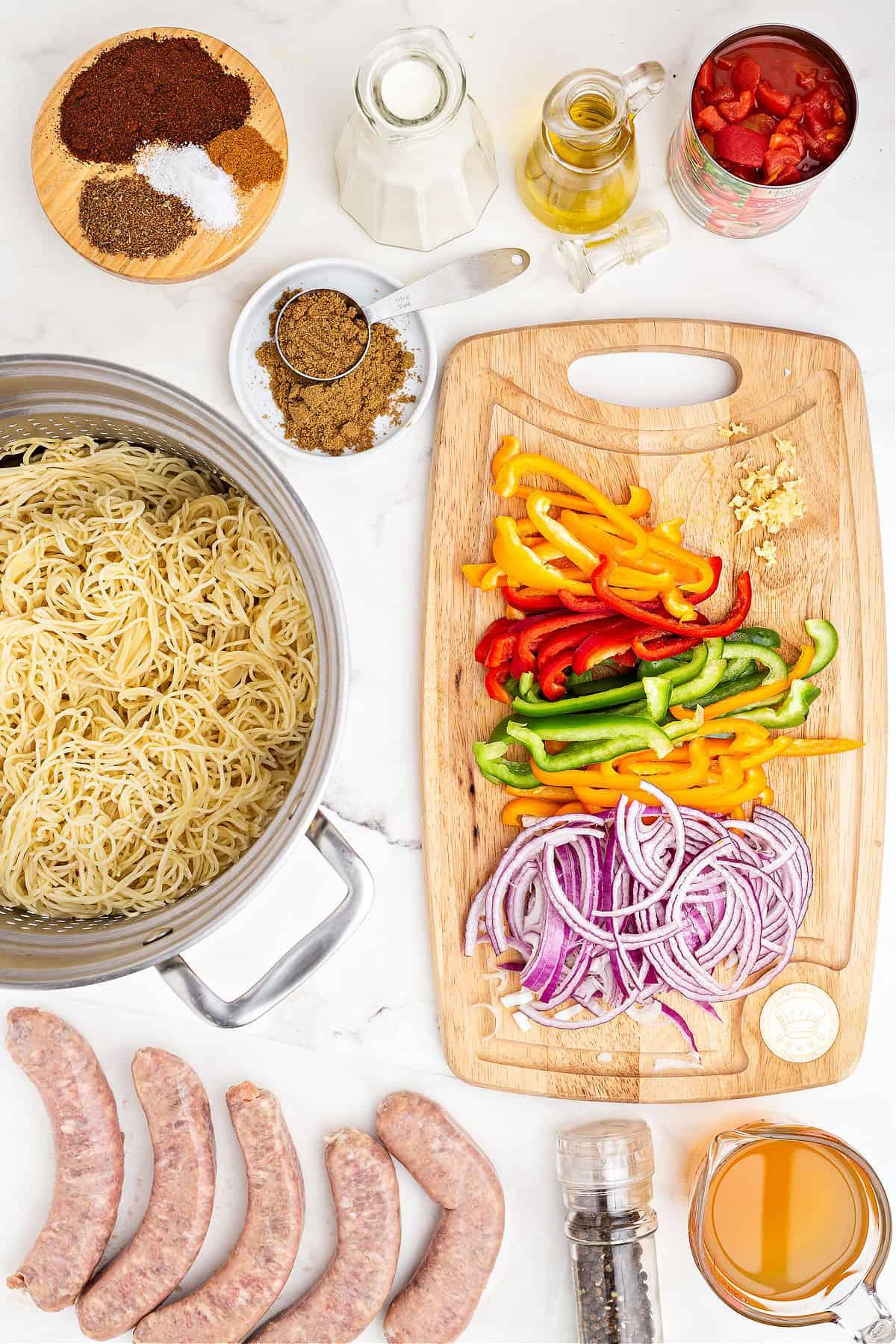 Ingredients needed for cajun sausage pasta.