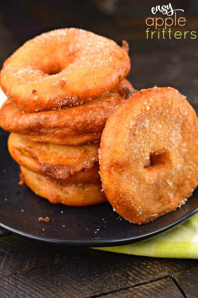 Delicious Apple Ring Fritters start with juicy apples and a buttermilk batter before frying to a golden brown! Then coat them in sugar and serve with your favorite caramel or chocolate dippers!