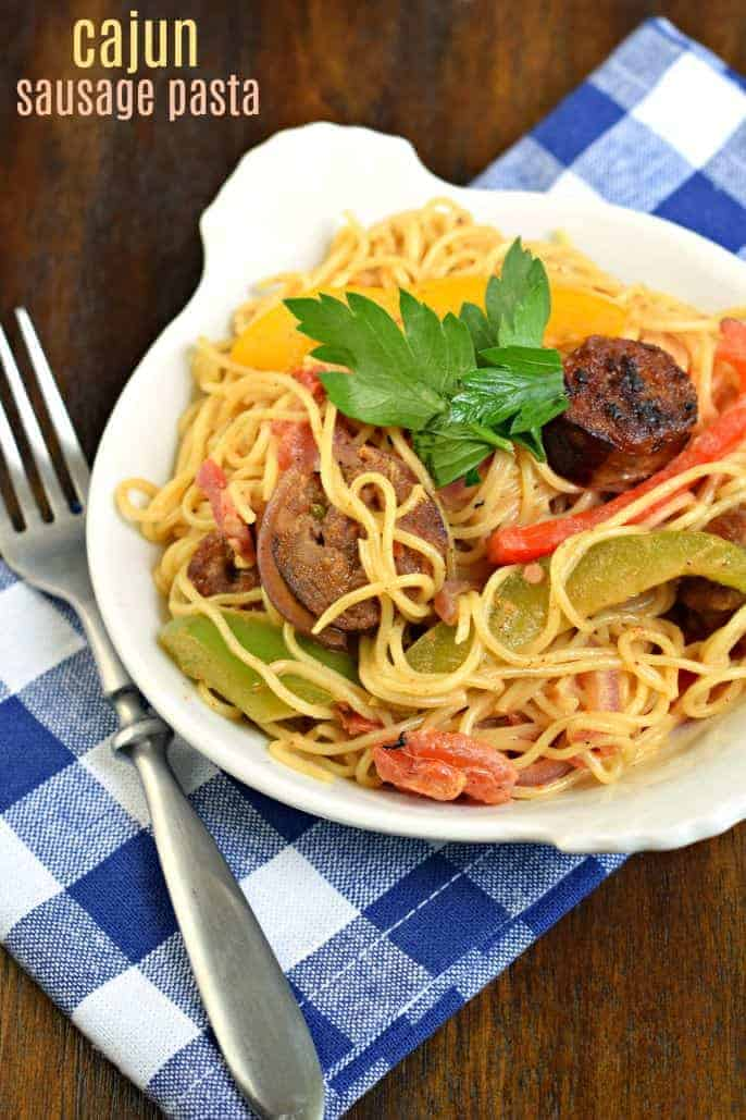 Cajun Sausage Pasta is a delicious 30 minute dinner recipe! Colorful, spicy, and easy to make, you'll want to put this dish on your menu!