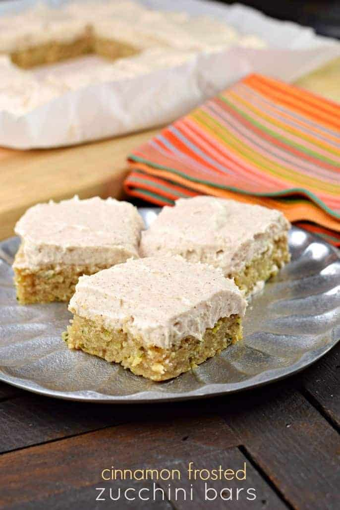 Easy and delicious, these chewy Cinnamon Frosted Zucchini Cake Bars are the perfect sweet dessert any time of year!