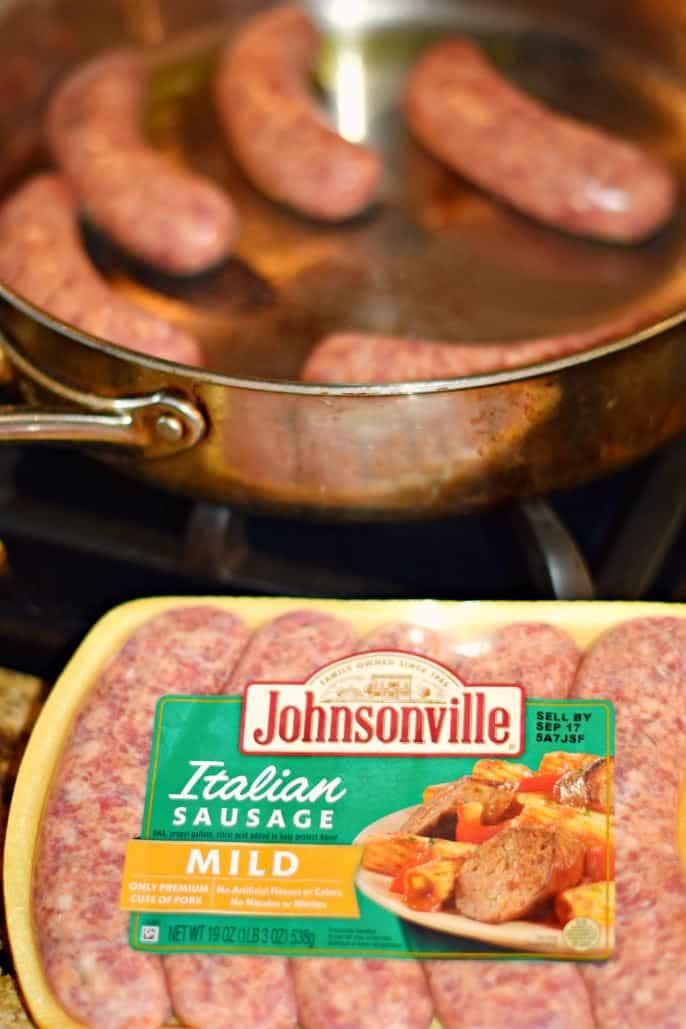 Mild Italian sausage cooking in skillet.