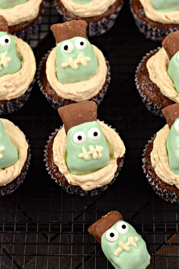Butterfinger cupcakes on a wire rack with frankenstein decorations.