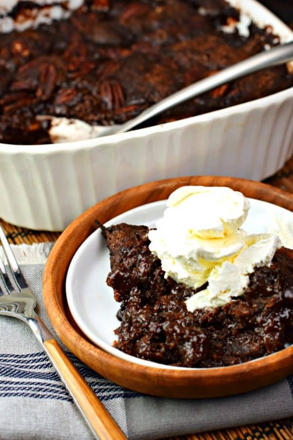 This classic, southern Chocolate Cobbler recipe has a rich, fudgy sauce topped with a decadent brownie-like topping! #farfromordinarymilk #sponsored #chocolate #cobbler
