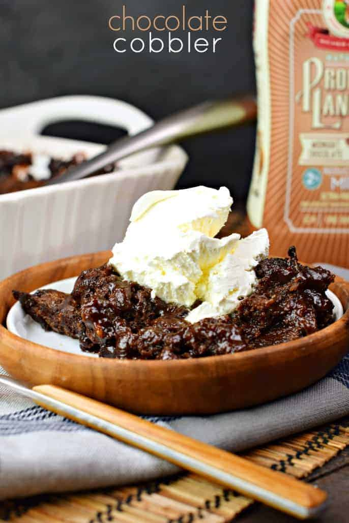 This classic, southern Chocolate Cobbler recipe has a rich, fudgy sauce topped with a decadent brownie-like topping!