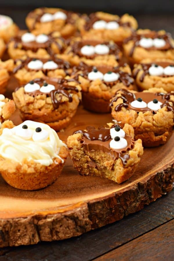 These Halloween Peanut Butter Cookie Cups start with a 3 ingredient, flourless cookie! Add your favorite candy and make a spooky treat this holiday!