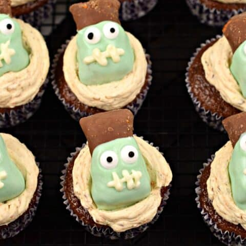 Chocolate cupcakes with butterfinger frosting and decorated with a frankenstein candy.