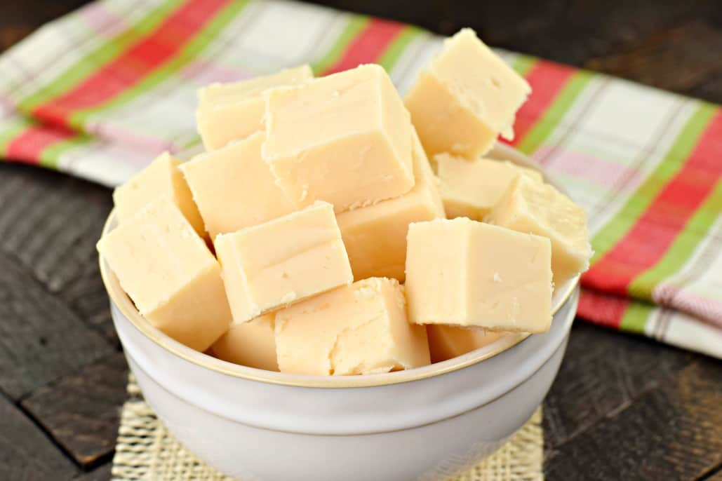 White bowl with pieces of butter rum fudge candy.