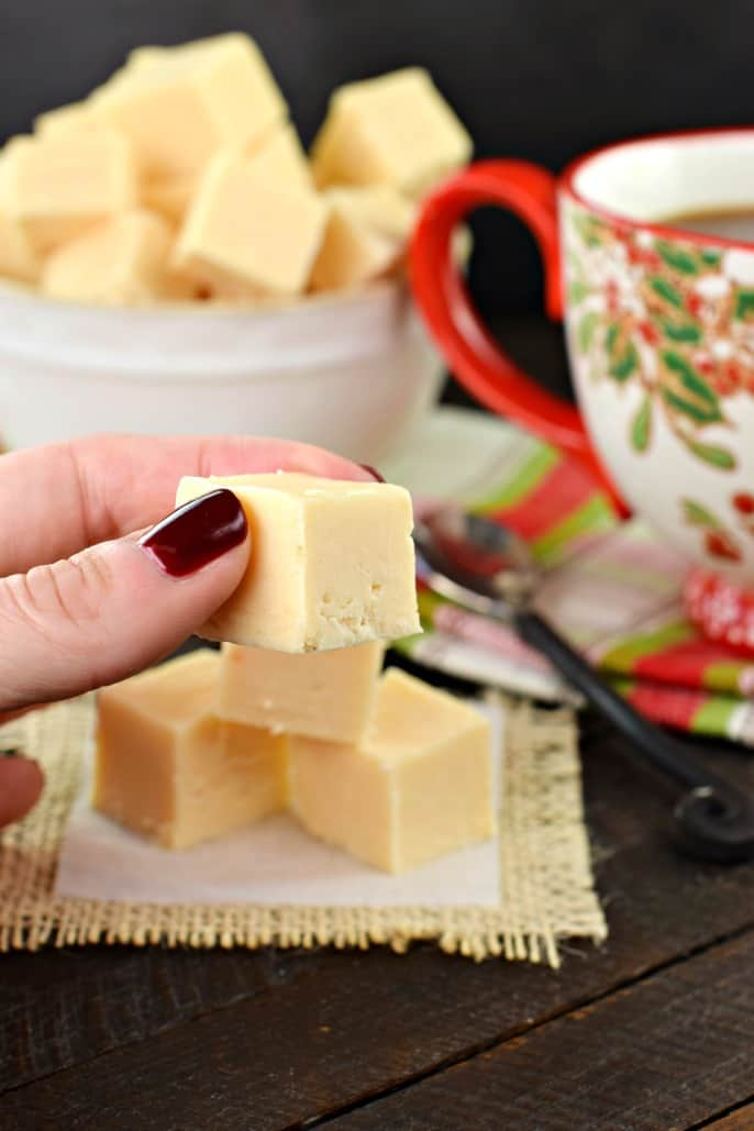 Piece of butter rum fudge being held for close up.
