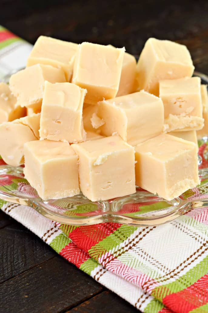 Pieces of butter rum fudge on clear glass plate.